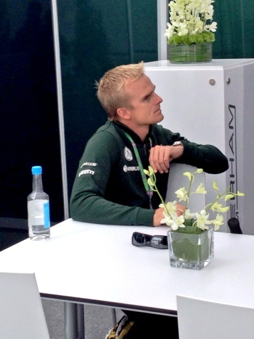 Heikki just chilling in the Caterham hospitality suite