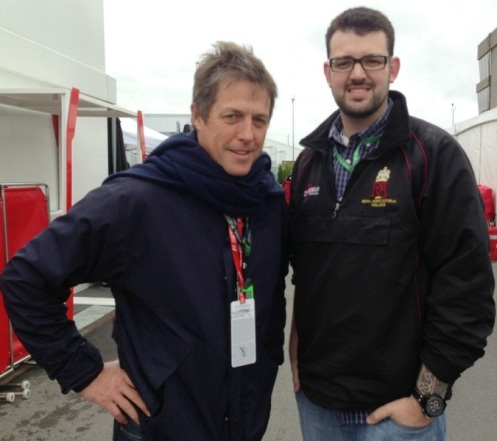 My friend Jordan Irvine  photographed with Actor Hugh Grant in the paddock