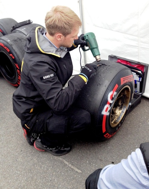 Pirelli engineers taking a little off the top.  Strange rituals in the paddock...I normally get my haircut before a GP