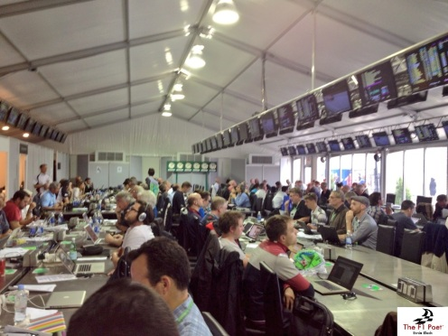 Here is a quick shot of the Media Centre.  Can you spot Adam Hay Nicholls?  This is where most of us watch the race.  Of course, some of us sneak out to catch some action live from track-side whenever possible.  Strategically, some journalists pop out and run to chat with key team people to get specific information during the race.